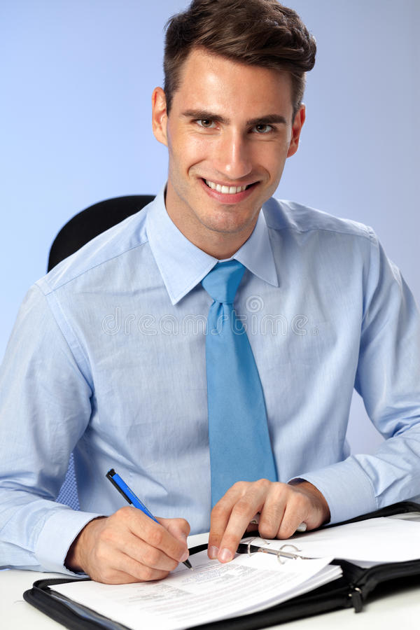 Handsome business writing on papers stock photo