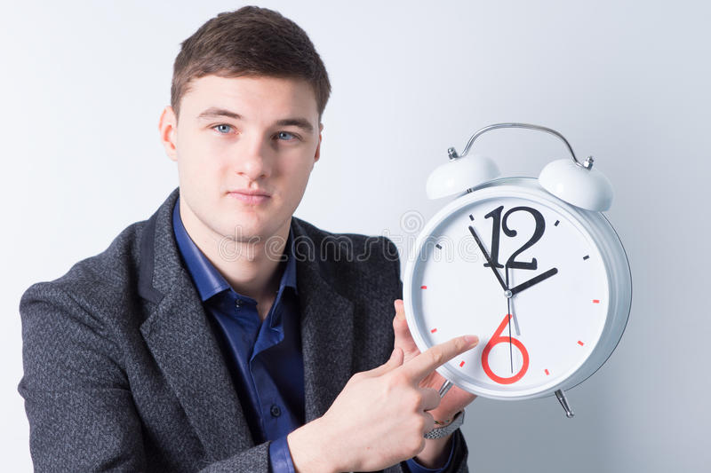 Handsome Businessman Advertising Alarm Clock royalty free stock images