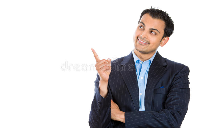 Handsome businessman or attorney or politician pointing to copy space at left stock image