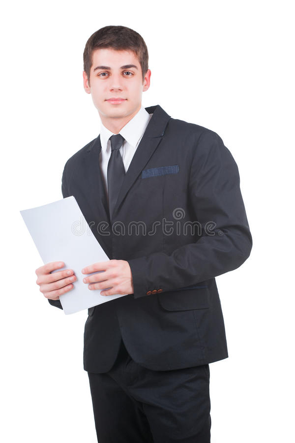 Handsome businessman with blank paper. Young handsome businessman holding a blank white paper isolated on white royalty free stock photography