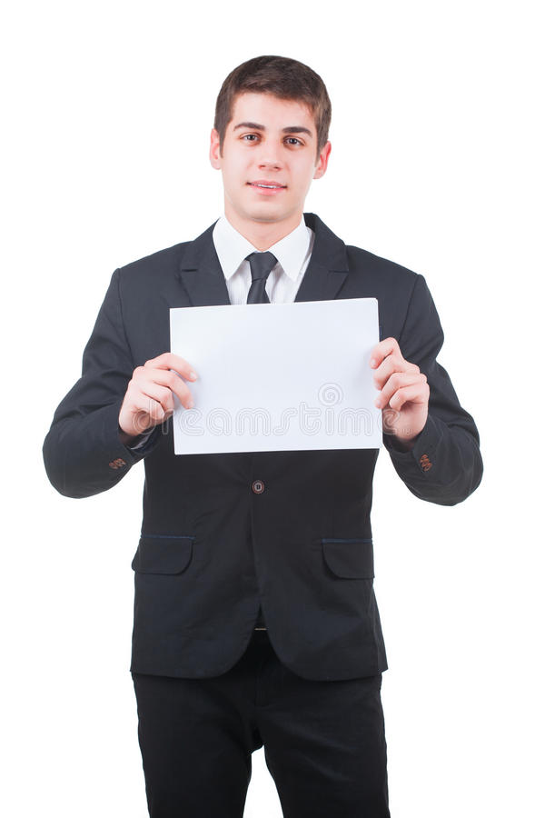 Handsome businessman with blank paper. Young handsome businessman holding a blank white paper isolated on white royalty free stock image