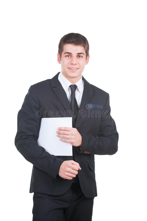 Handsome businessman with blank paper. Young handsome businessman holding a blank white paper isolated on white royalty free stock photos