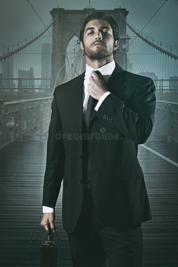 Handsome businessman and Brooklyn bridge royalty free stock photos