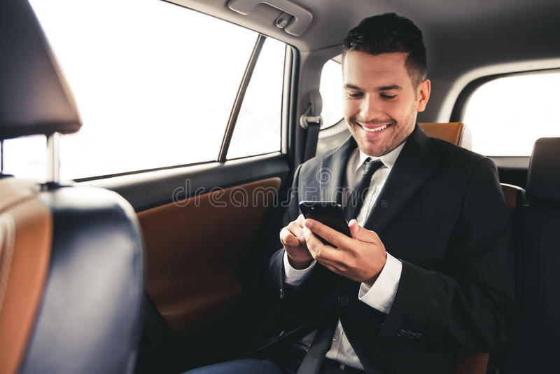 Handsome businessman in car royalty free stock images