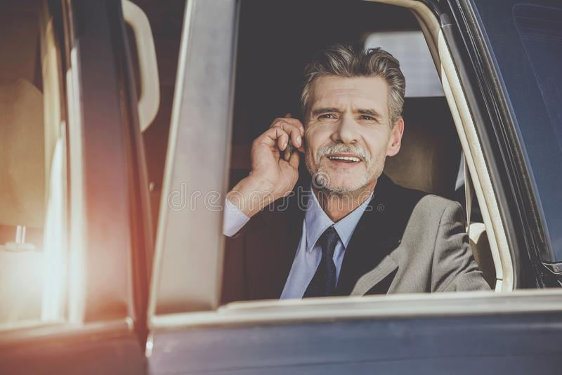 Handsome Businessman in Car Talking on Smartphone. royalty free stock photo