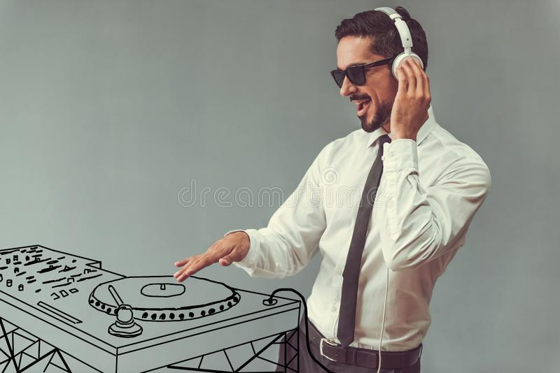 Handsome businessman and dj stock photography