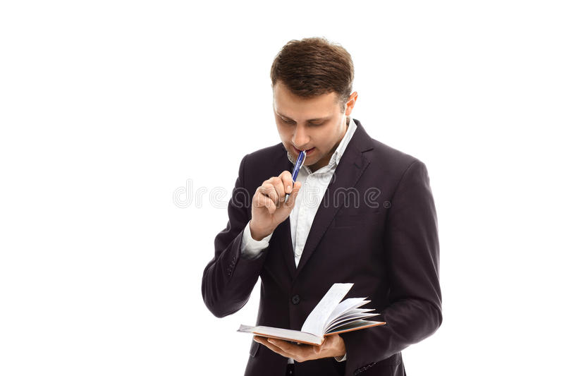 Handsome businessman with diary. Handsome businessman in suit with diary isolated on white royalty free stock images
