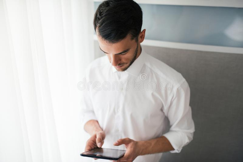 Handsome businessman doing some notices in the offic. Business and people concept stock images