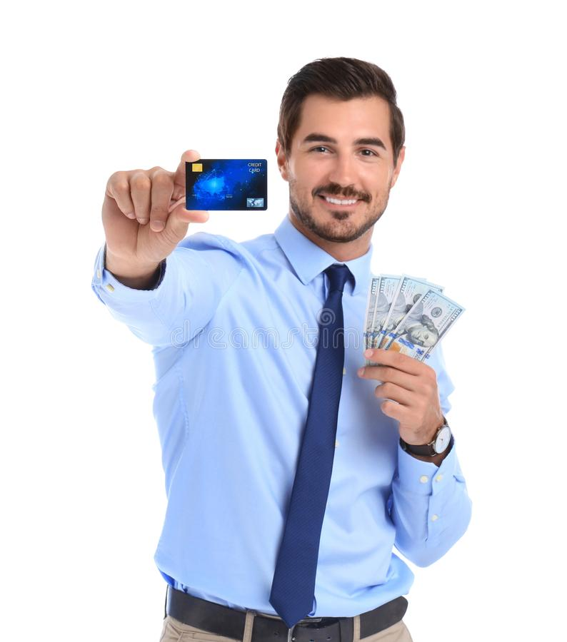 Handsome businessman with dollars and credit card. On white background stock photos