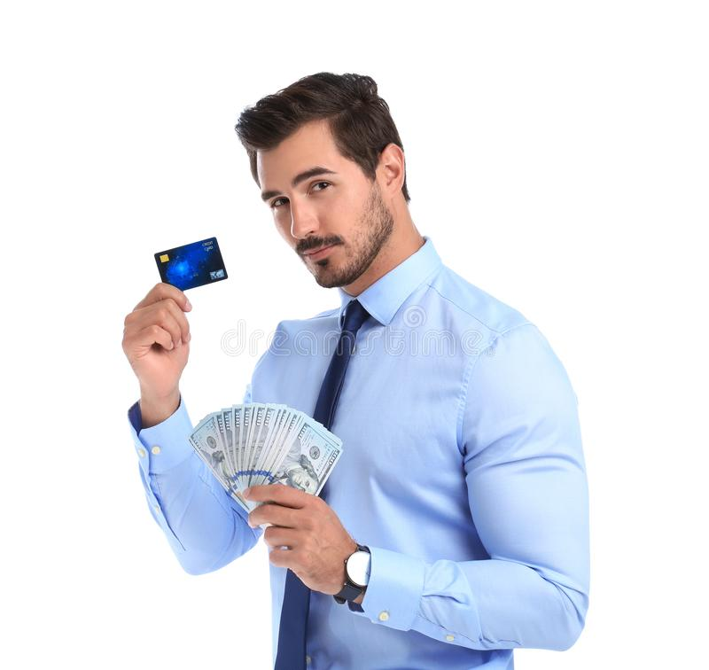 Handsome businessman with  and credit card on white background. Handsome businessman with dollars and credit card on white background royalty free stock image