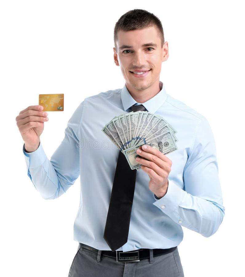 Businessman with dollars and credit card on white background. Handsome businessman with dollars and credit card on white background royalty free stock images