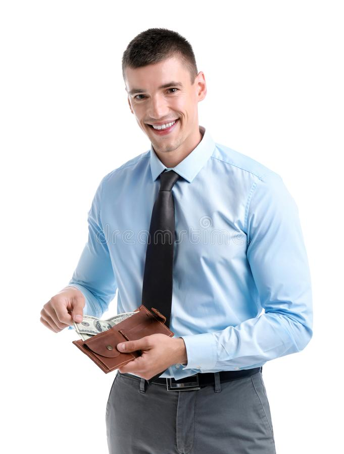 Handsome businessman with dollars in wallet on white. Background stock image