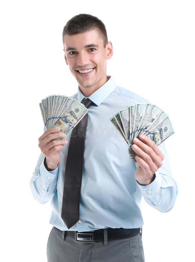 Handsome businessman  dollars on white background. Handsome businessman with dollars on white background royalty free stock photos