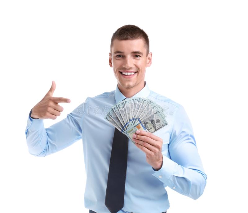 Handsome businessman with dollars. On white background stock photo