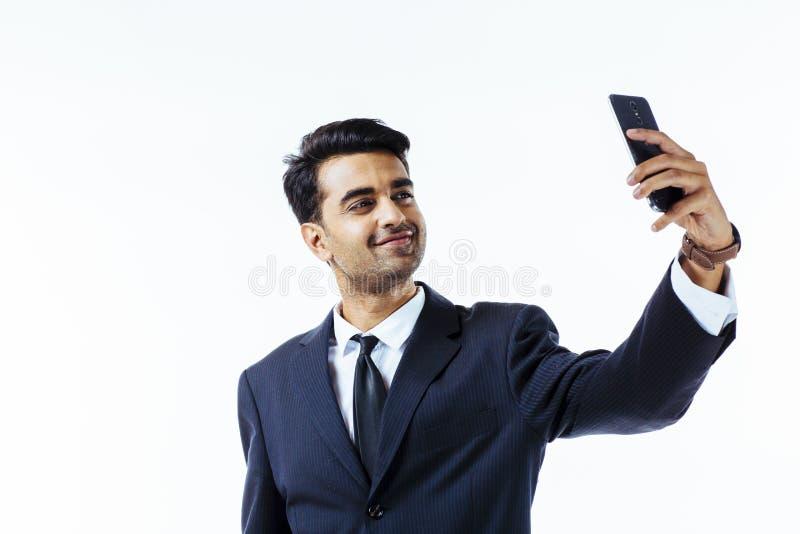 Handsome businessman entrepreneur taking a selfie. Selfie time. Portrait of a handsome entrepreneur businessman taking a selfie. on a white isolated background royalty free stock photos