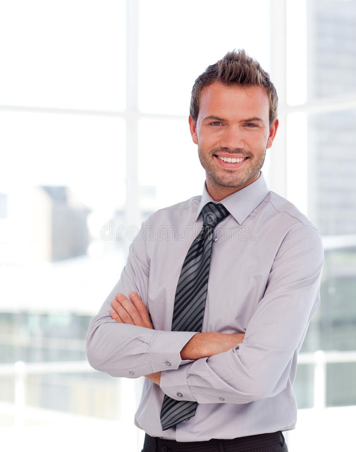 Handsome businessman with folded arms royalty free stock photo