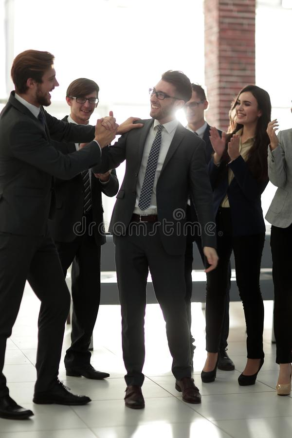 Businessmen are congratulating their successful sales. stock images