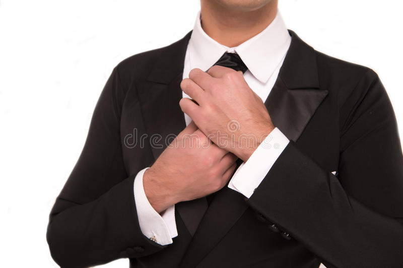 Handsome businessman or groom in fashionable suit isolated on white. Handsome young businessman or gentleman guy in fashionable black formal suit of jacket royalty free stock image