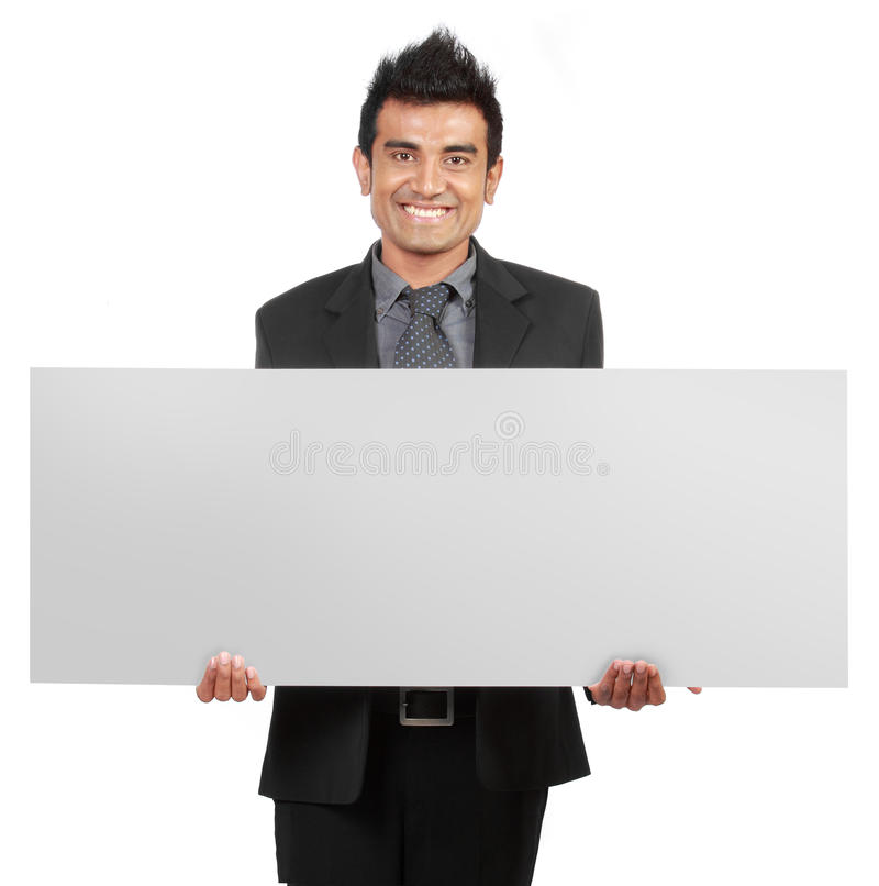 Handsome Businessman holding a blank sign stock image