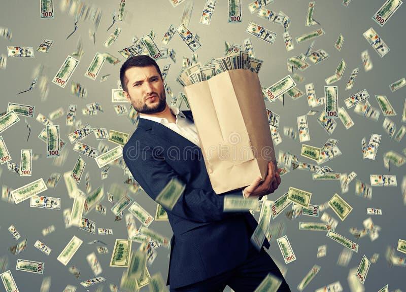 Handsome businessman holding money royalty free stock image