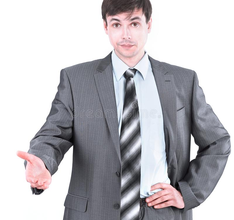 Handsome businessman holding out his hand for greeting. Isolated on a light background stock photos