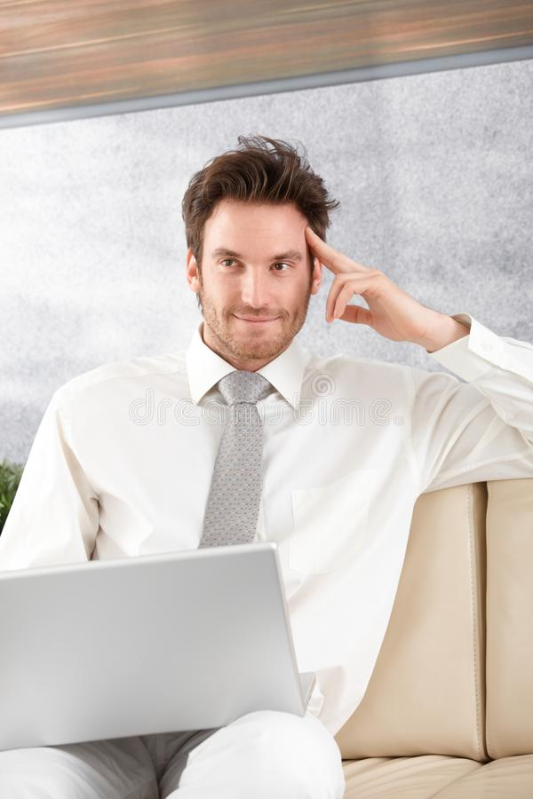 Download Handsome Businessman With Laptop Smiling Royalty Free Stock Photo - Image: 20050465