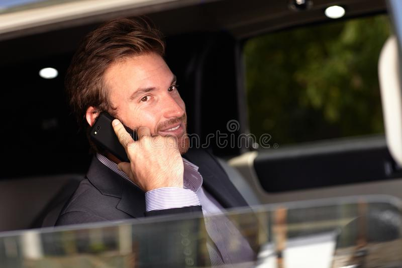 Download Handsome Businessman In Limousine Stock Photo - Image: 22953744