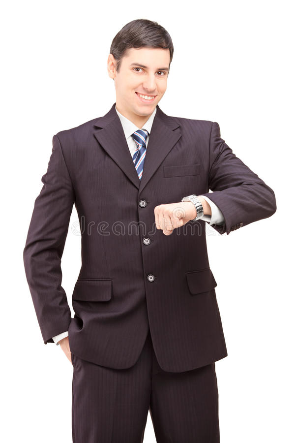 Handsome businessman looking at his watch royalty free stock photo