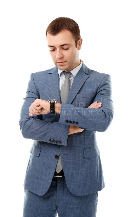 Handsome businessman looking at his watch , on white background royalty free stock image