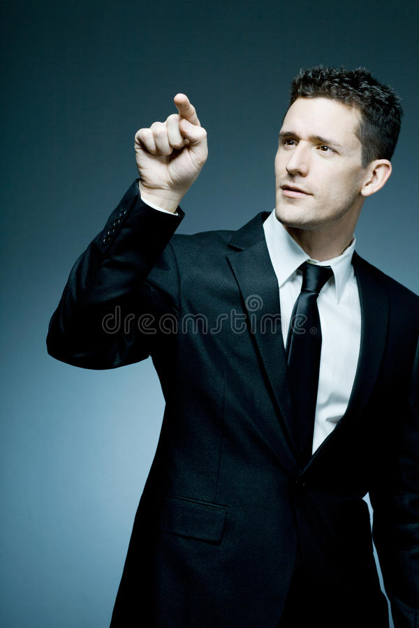 Download Handsome Businessman Making Pointing Gesture. Royalty Free Stock Photos - Image: 22109818