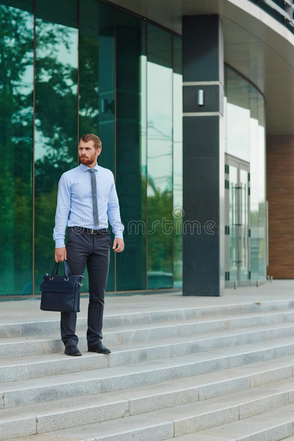 Handsome Businessman outside Office building stock image