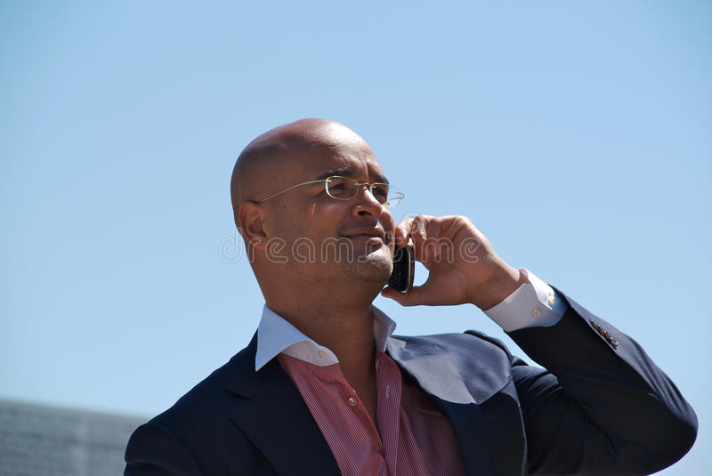 Handsome businessman with phone royalty free stock image
