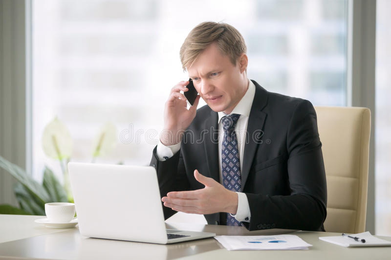 Handsome businessman with phone stock images