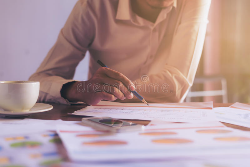 Handsome Businessman pointing to something or touching a touch s stock image