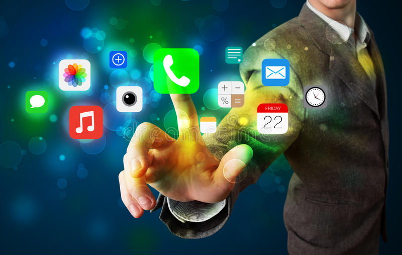 Handsome businessman pressing colorful mobile app icons with bokeh background. Businessman pressing colorful mobile app icons with bokeh background royalty free illustration