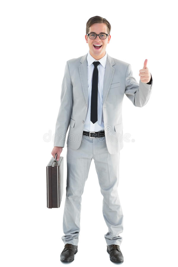 Handsome businessman showing thumbs up. On white background royalty free stock photo