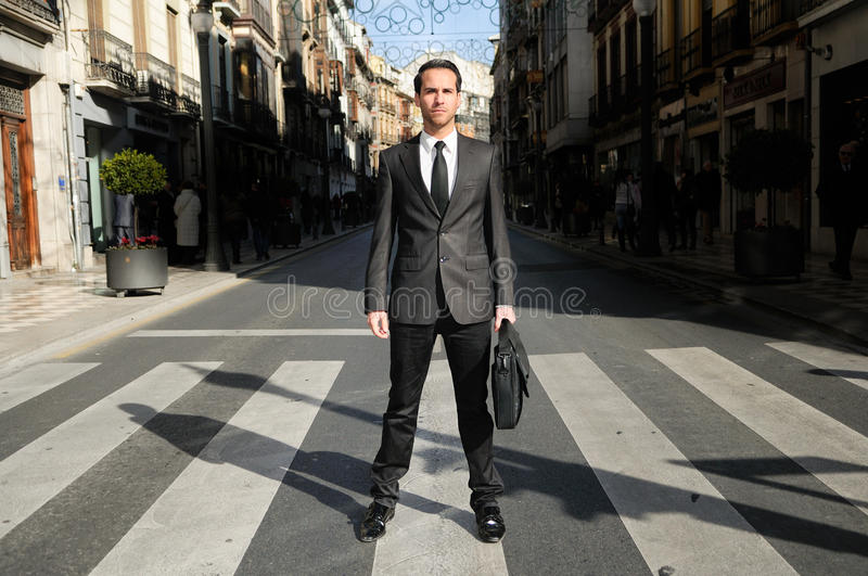 Download Handsome Businessman Standing In A Crosswalk Editorial Photography - Image: 23488477