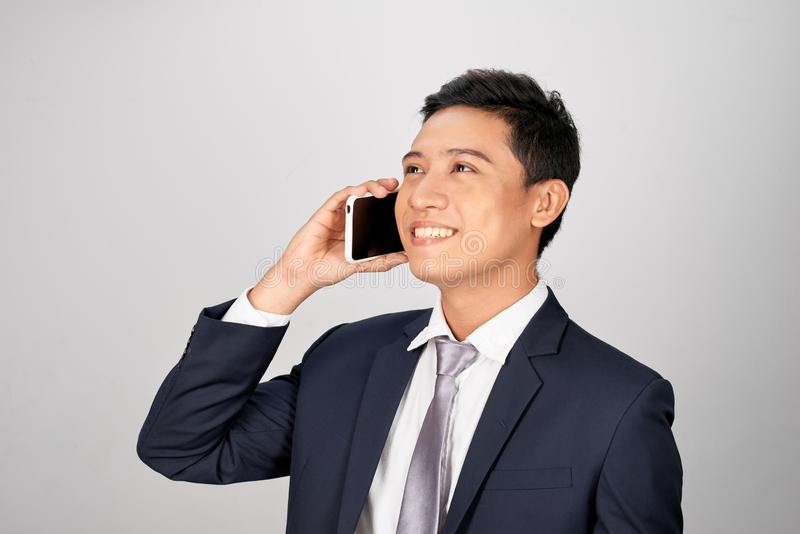 Handsome businessman in suit and eyeglasses speaking on the phone.  stock photo