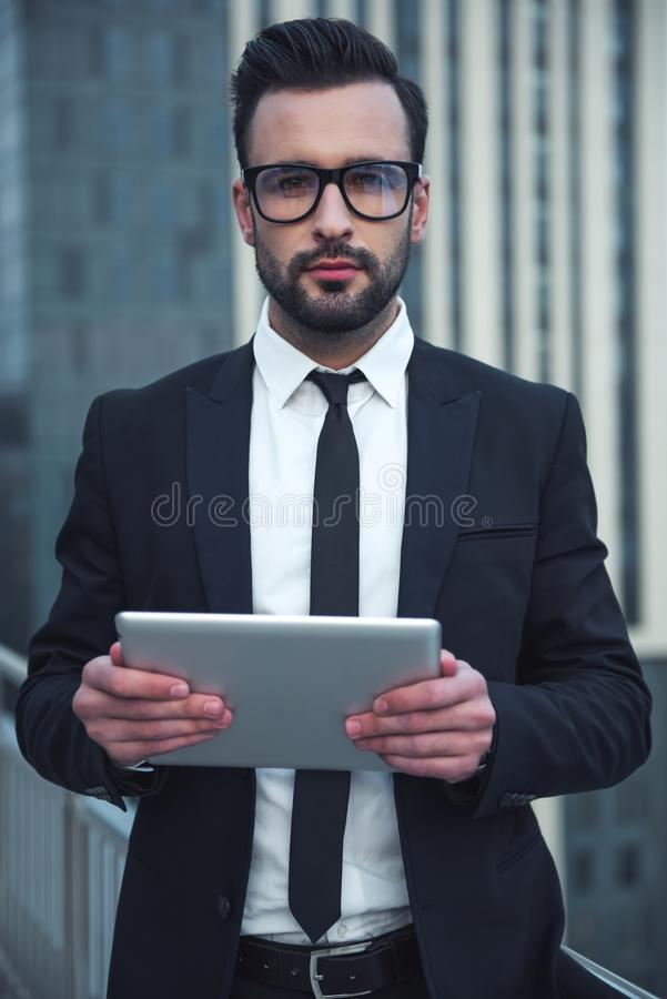 Handsome businessman outdoors stock photography