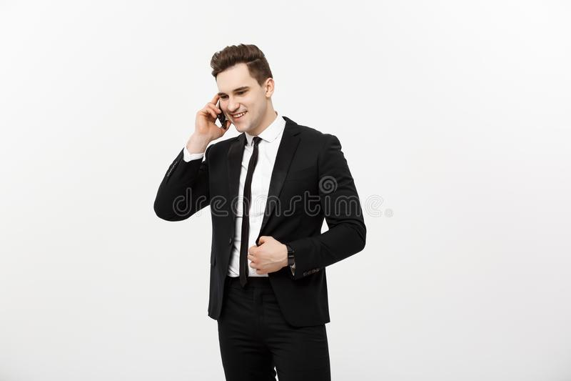 Handsome businessman in suit speaking on the phone over isolated white background. royalty free stock photo