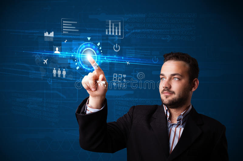 Handsome businessman touching future web technology buttons and. Businessman touching future web technology buttons and icons royalty free stock image