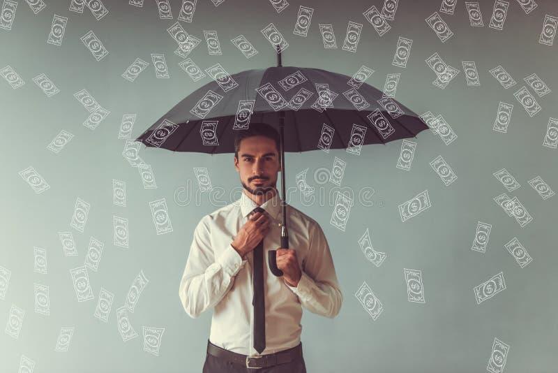 Handsome businessman with umbrella stock photos