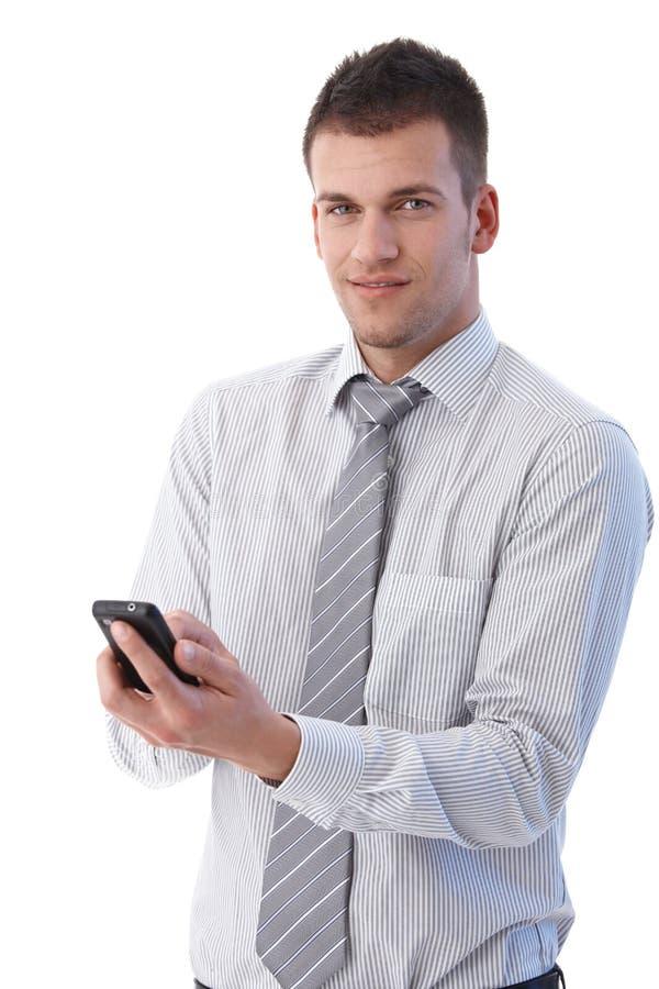 Download Handsome Businessman Using Mobile Phone Stock Image - Image: 20531435