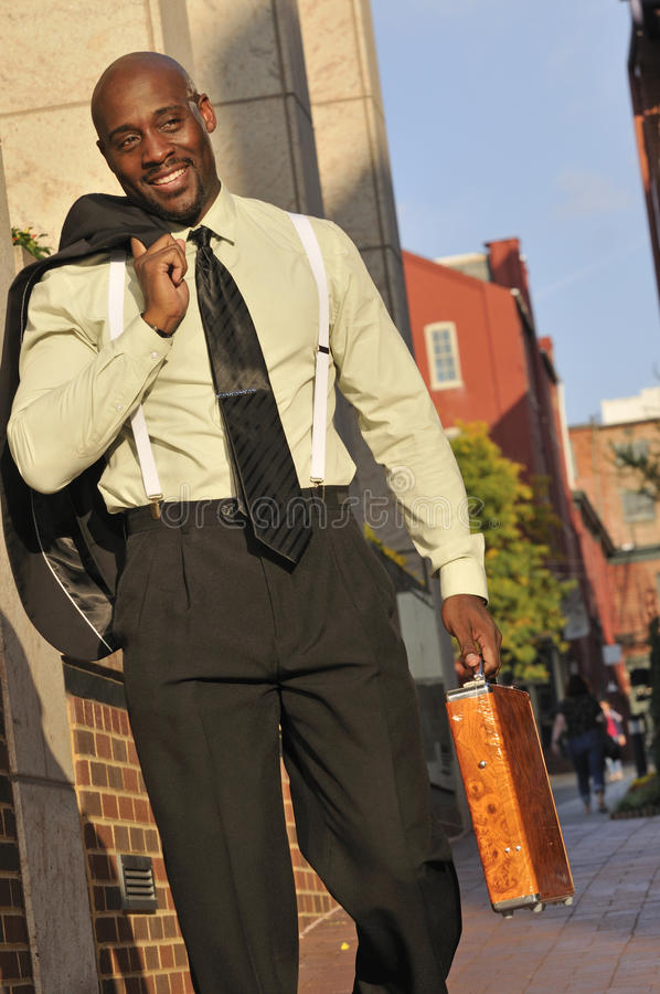 Handsome Businessman Walking Outdoors With Suitcase royalty free stock image