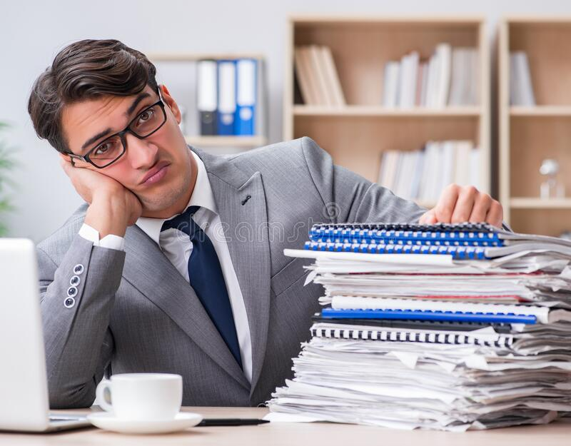 Handsome businessman working in the office stock photography