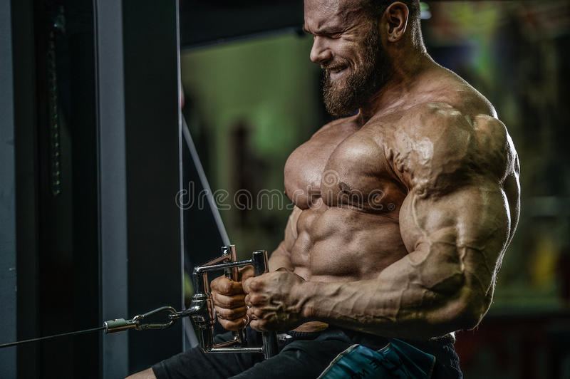 Handsome caucasian athlete muscular fitness male model execute e stock images