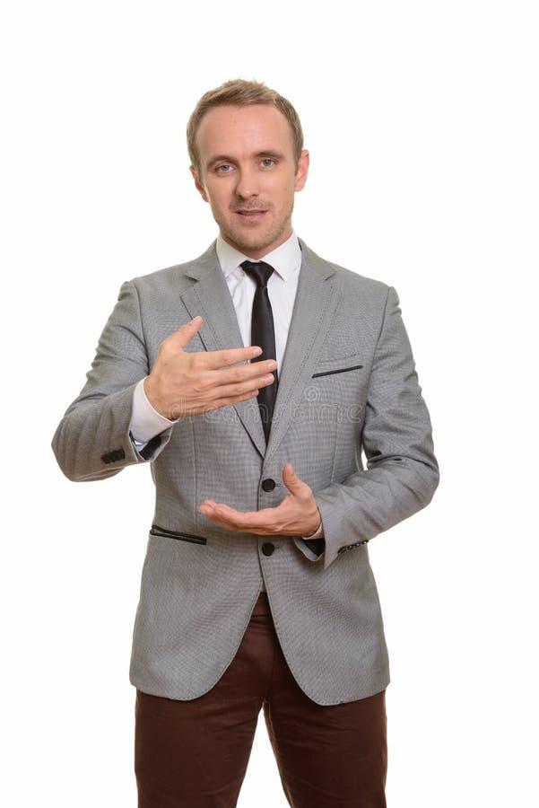 Free Handsome Caucasian Businessman Explaining Isolated Against White Background Royalty Free Stock Photo - 136453695