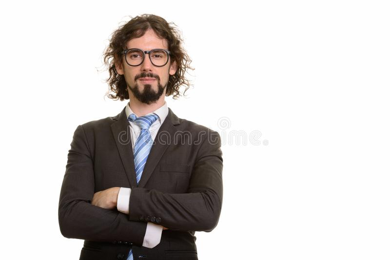 Portrait of handsome Caucasian businessman with arms crossed royalty free stock photography