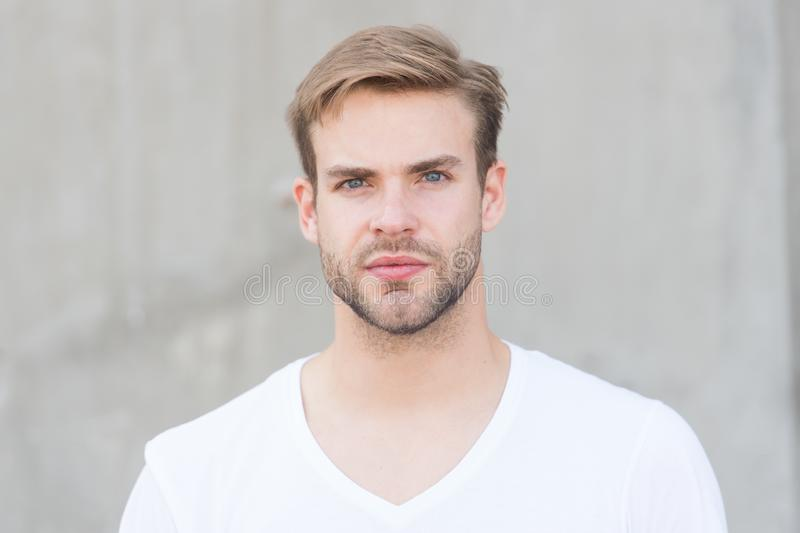 Handsome caucasian man gray background. Bearded guy casual style close up. Male beauty standards. Ideal traits that make stock image