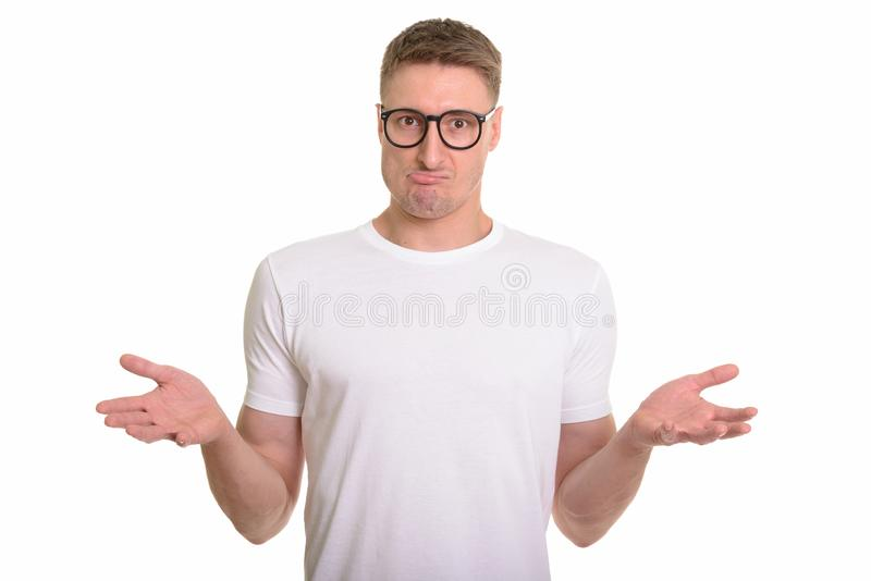 Handsome Caucasian man isolated against white background. Studio shot of young man isolated against white background stock photography